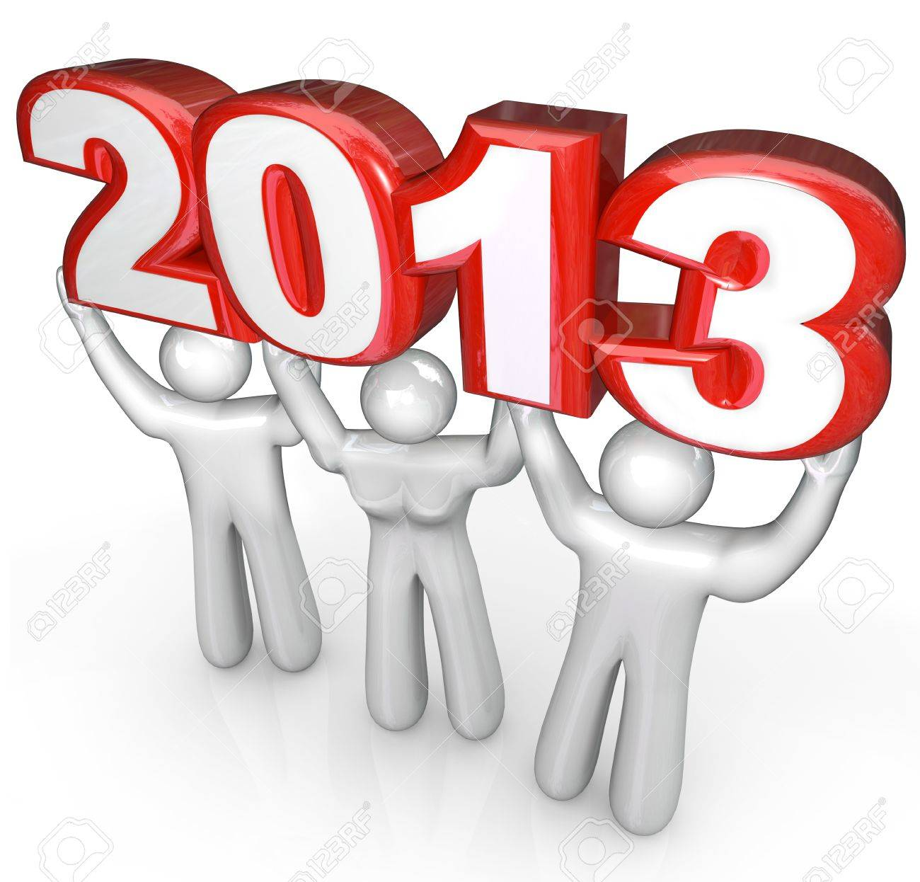A team of people celebrate the new year holiday by lifting the number 2013 in a party or celebration Stock Photo - 16261443