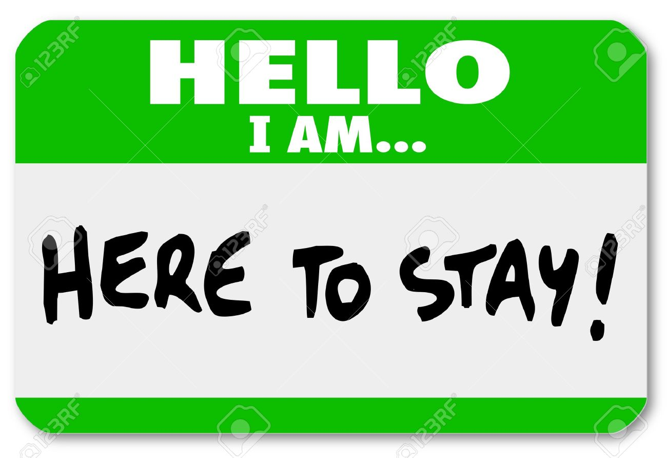 A namtag sticker with the words Hello I Am Here to Stay to symbolize