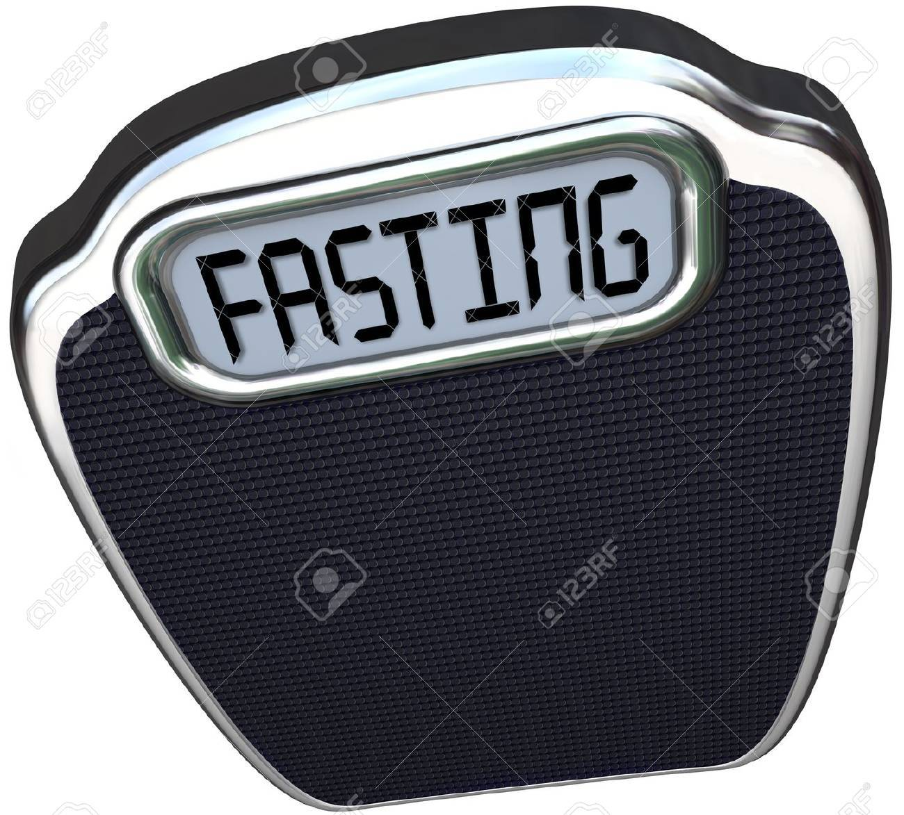 The word Fasting on a digital display of a scale to represent the new 5:2 diet fad or craze in which you reduce calories for two days and eat normally for five Stock Photo - 18985411