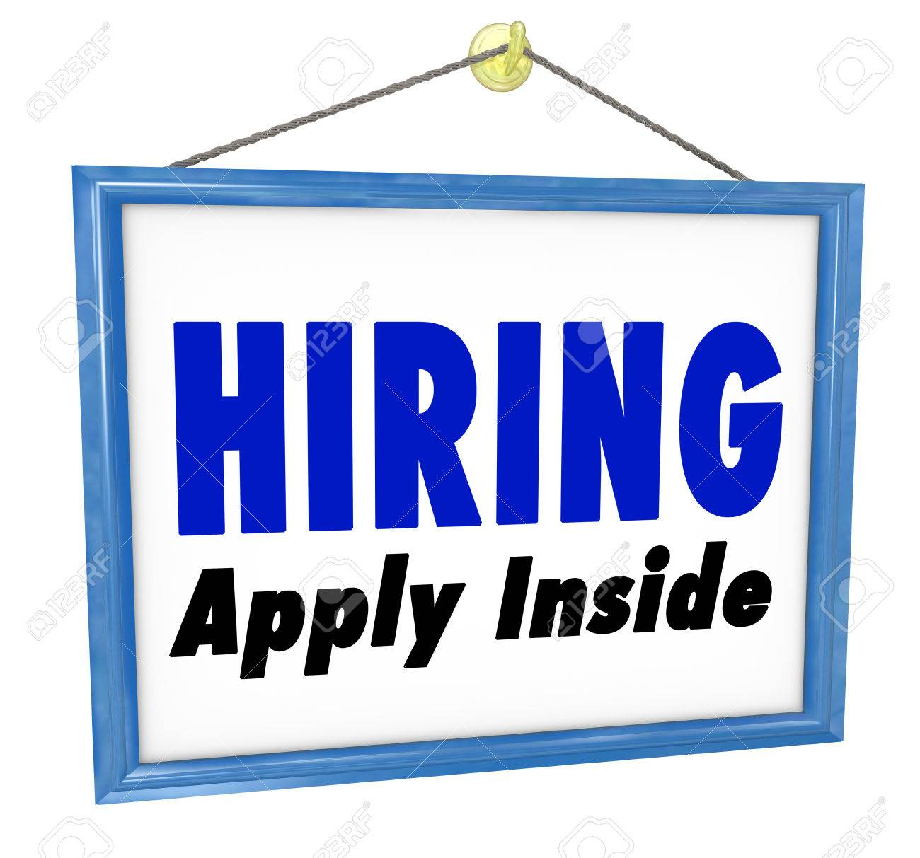 A sign hanging in a store or office with the words Hiring - Apply Inside to advertise an open position and seeking candidates for work and employment Stock Photo - 23173975