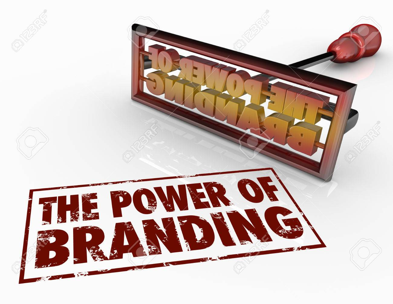 The Power of Branding words and a brand iron to illustrate trust, loyalty, identity and marketing awareness - 29496879
