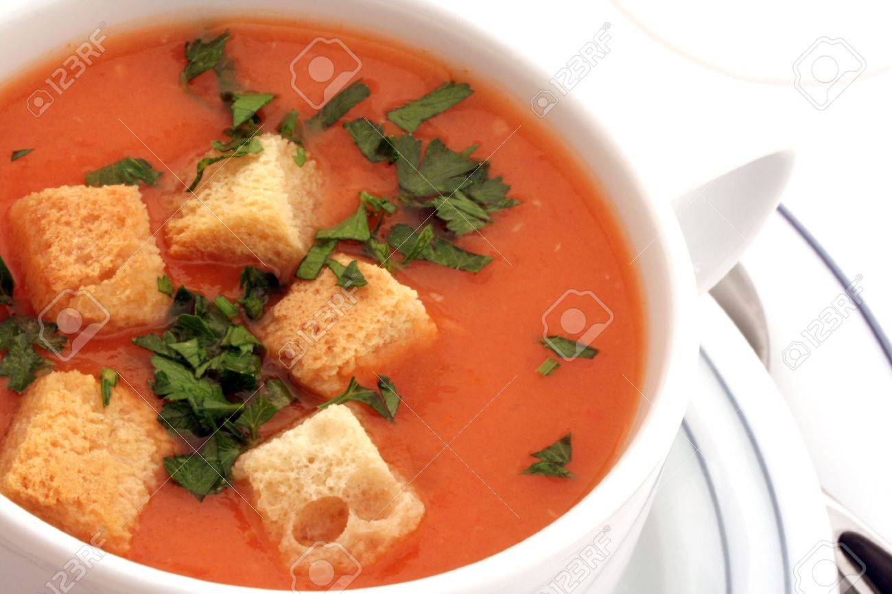 Tomato soup with croutons in ceramic bowl on white - 4657286