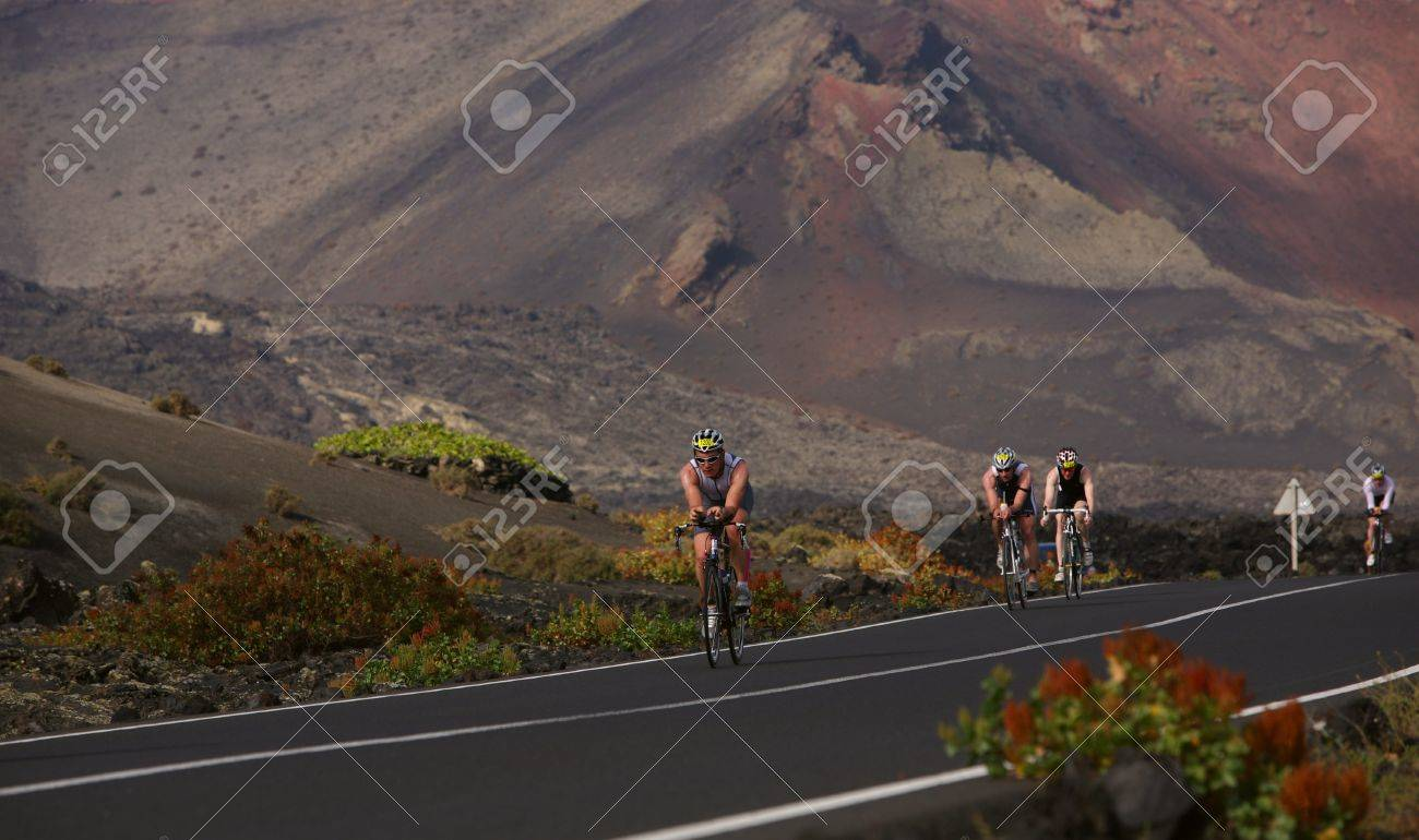 LANZAROTE, SPAIN - MAY 22: Group of cyclists in ironman Triathlon 2010 Event May 22 in Lanzarote Spain. - 7007411