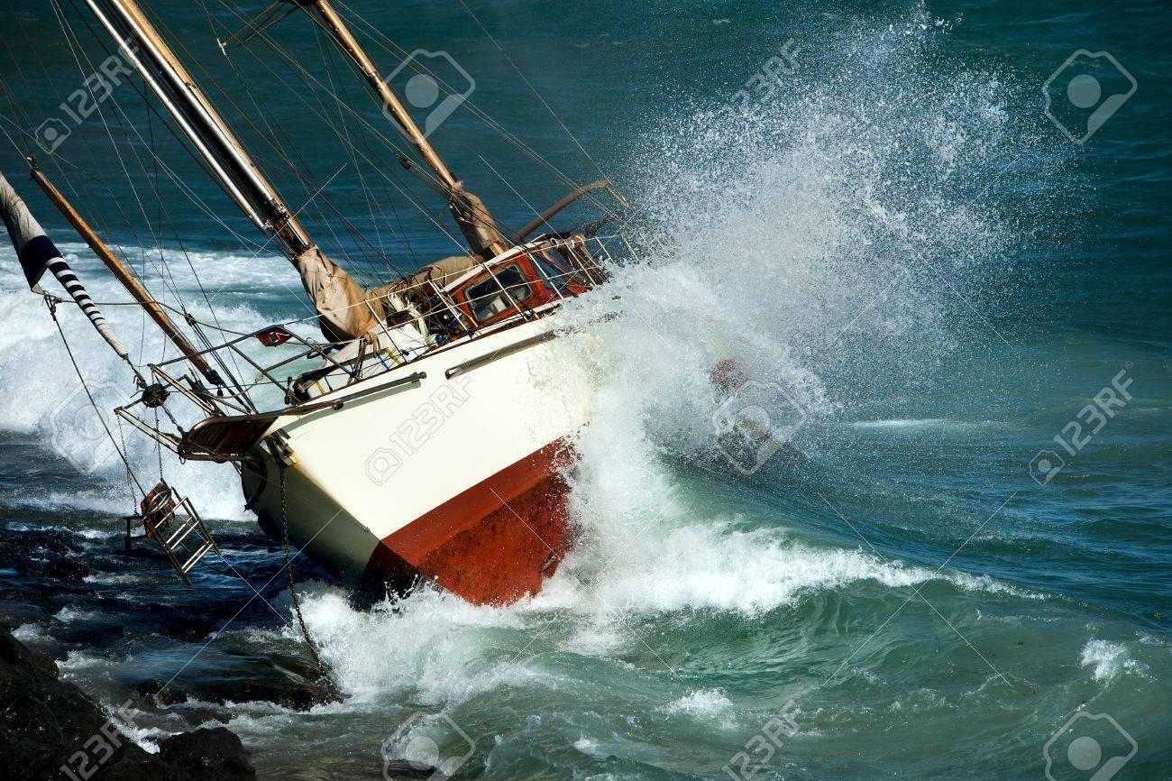 yacht crash on the rocks in stirmy weather - 12306797