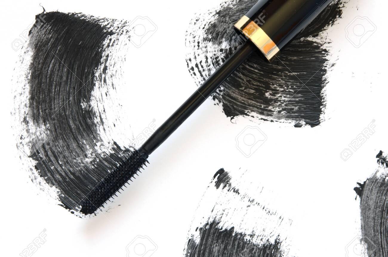 Stroke of black mascara with applicator brush close-up, isolated on white background. - Image - 126592074