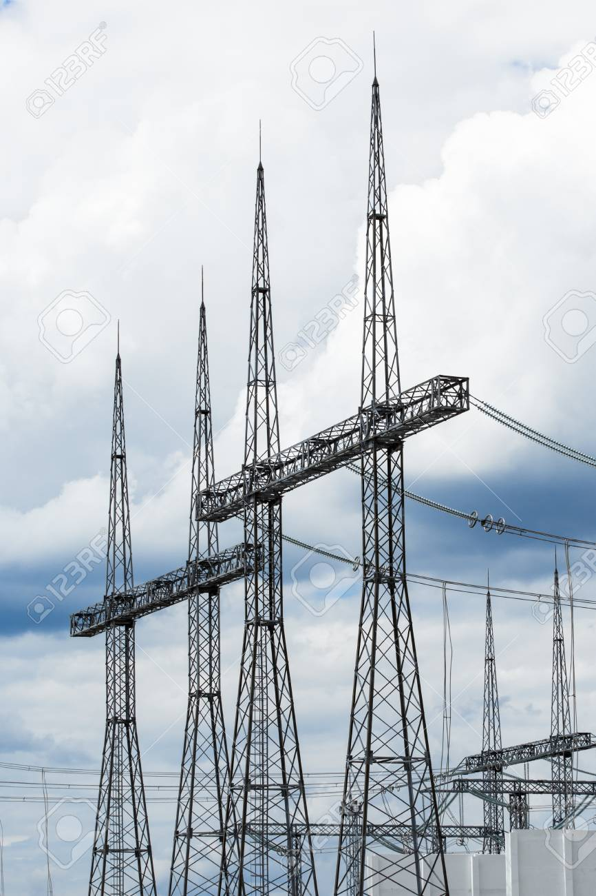 electric power transmission lines  high voltage switchgear and equipment in  front of power plant