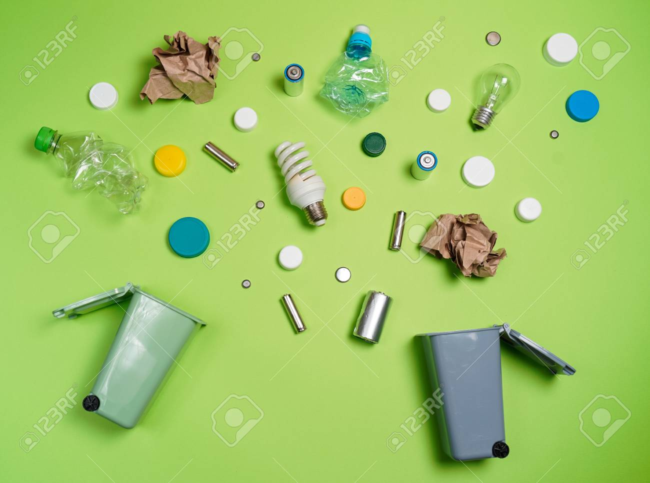 Trash bins and assorted garbage isolated on green, recycle concept, Top view - 113288927