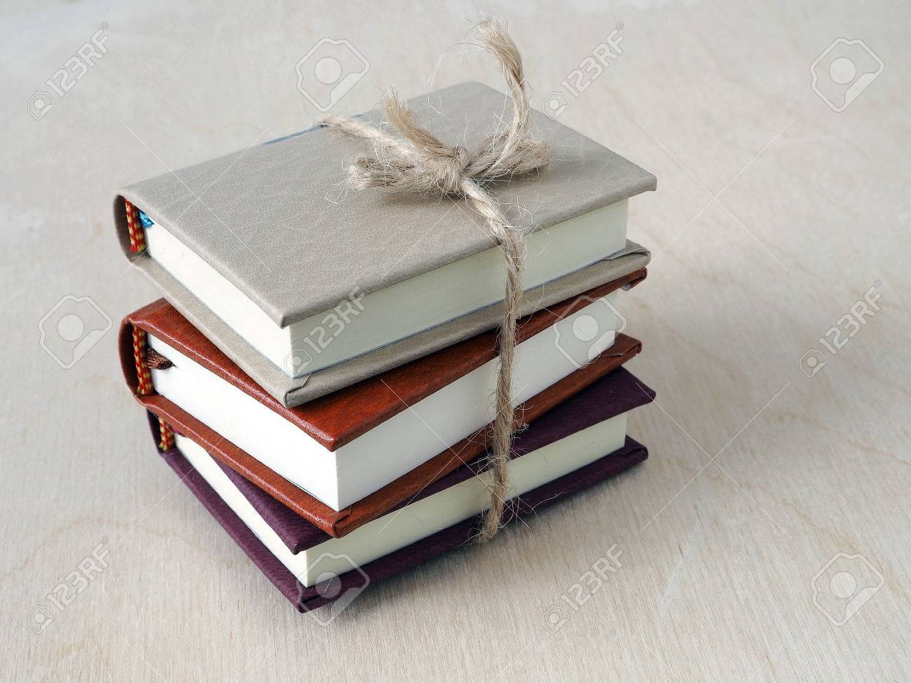 Back to School Concept  A Pile of Small Books Tied Up with a
