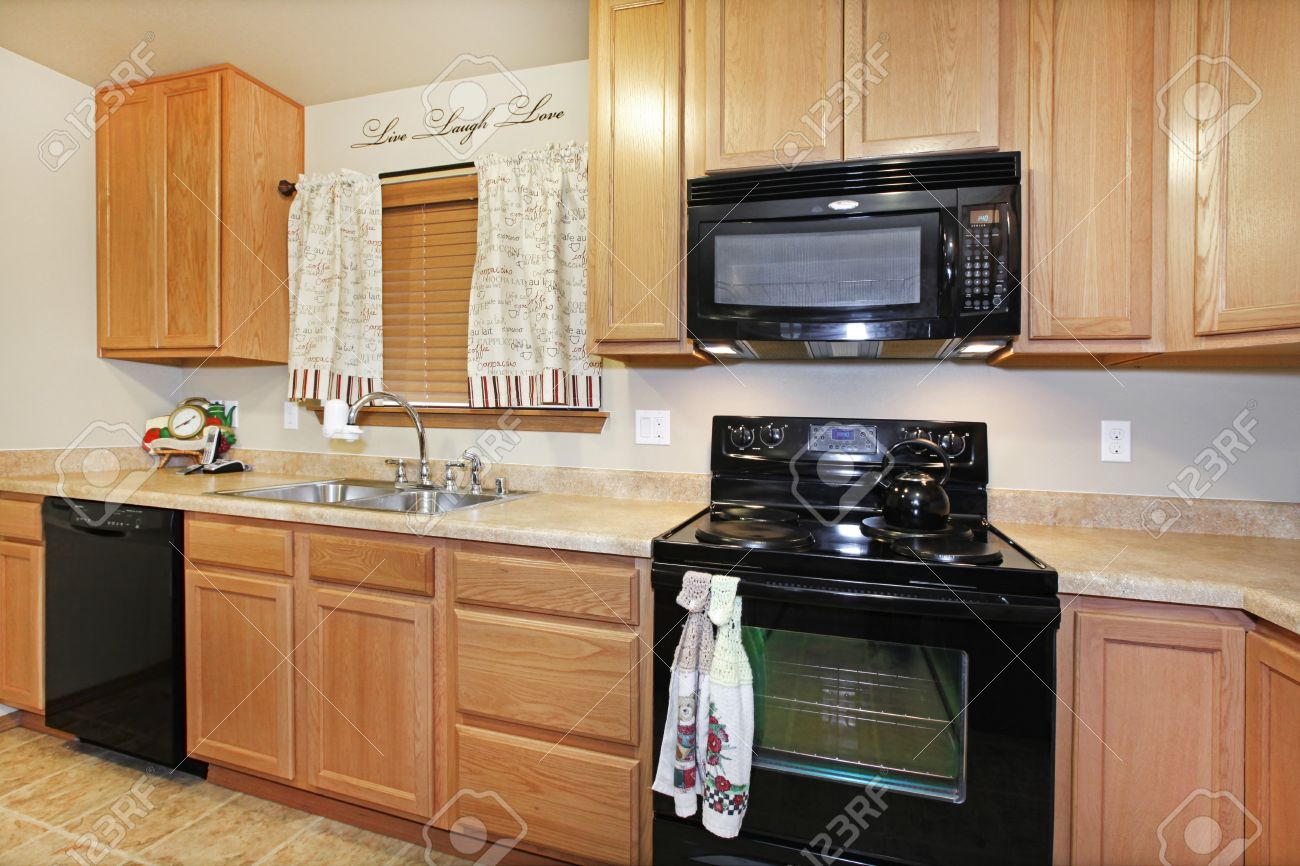 Light Color Kitchen With Black Appliances Stock Photo, Picture And ...