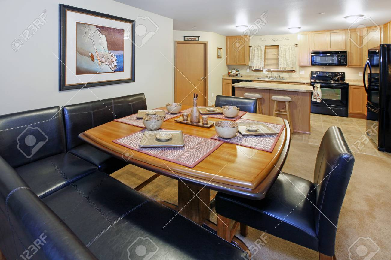 Dining room with black leather and kitchen view Stock Photo - 12313644