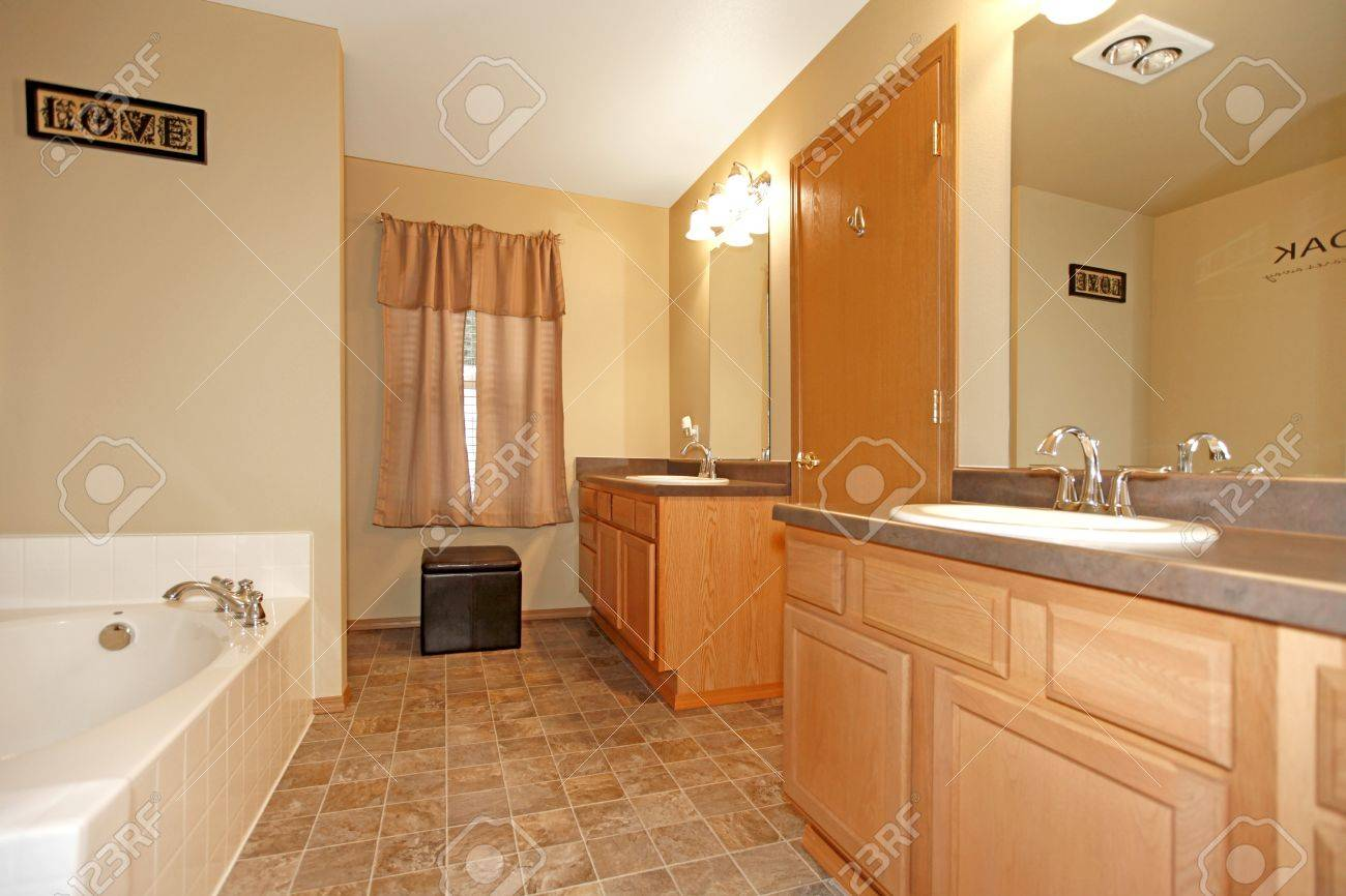Light green and white bathroom - Light Wood Bathroom With Light Green Walls And White Tub Stock Photo 12313553