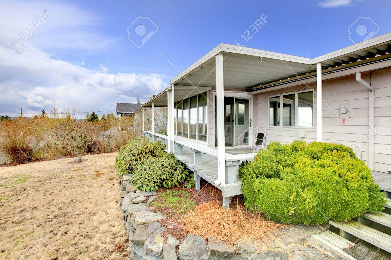 Back covered porch in the small old house Stock Photo - 12312910