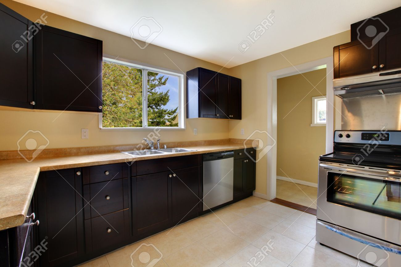 New Kitchen Furniture Kitchen Black Brown Cabinets And New Appliances Stock Photo