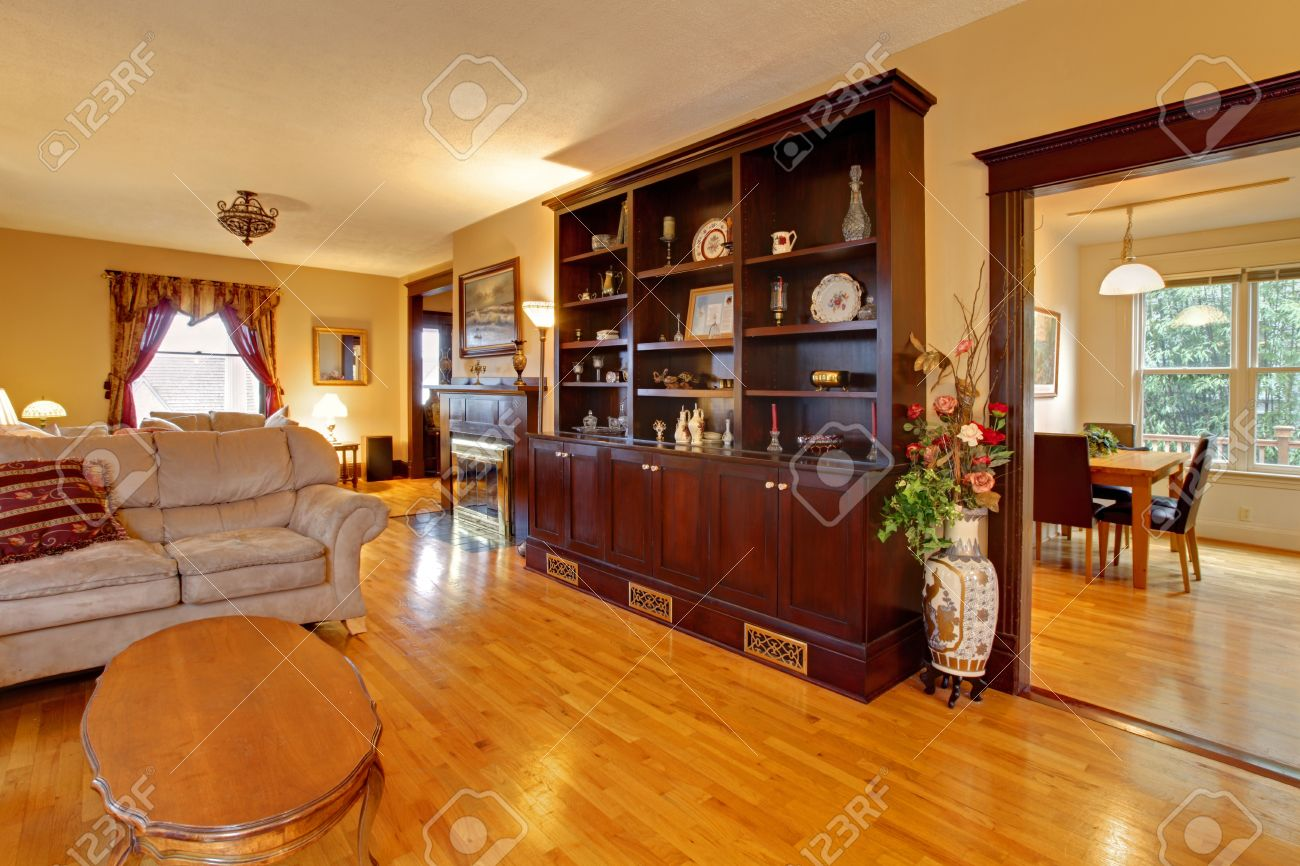 Brown gold and orange living room - Luxury Gold Living Room With Mahogany Wood Stock Photo Picture