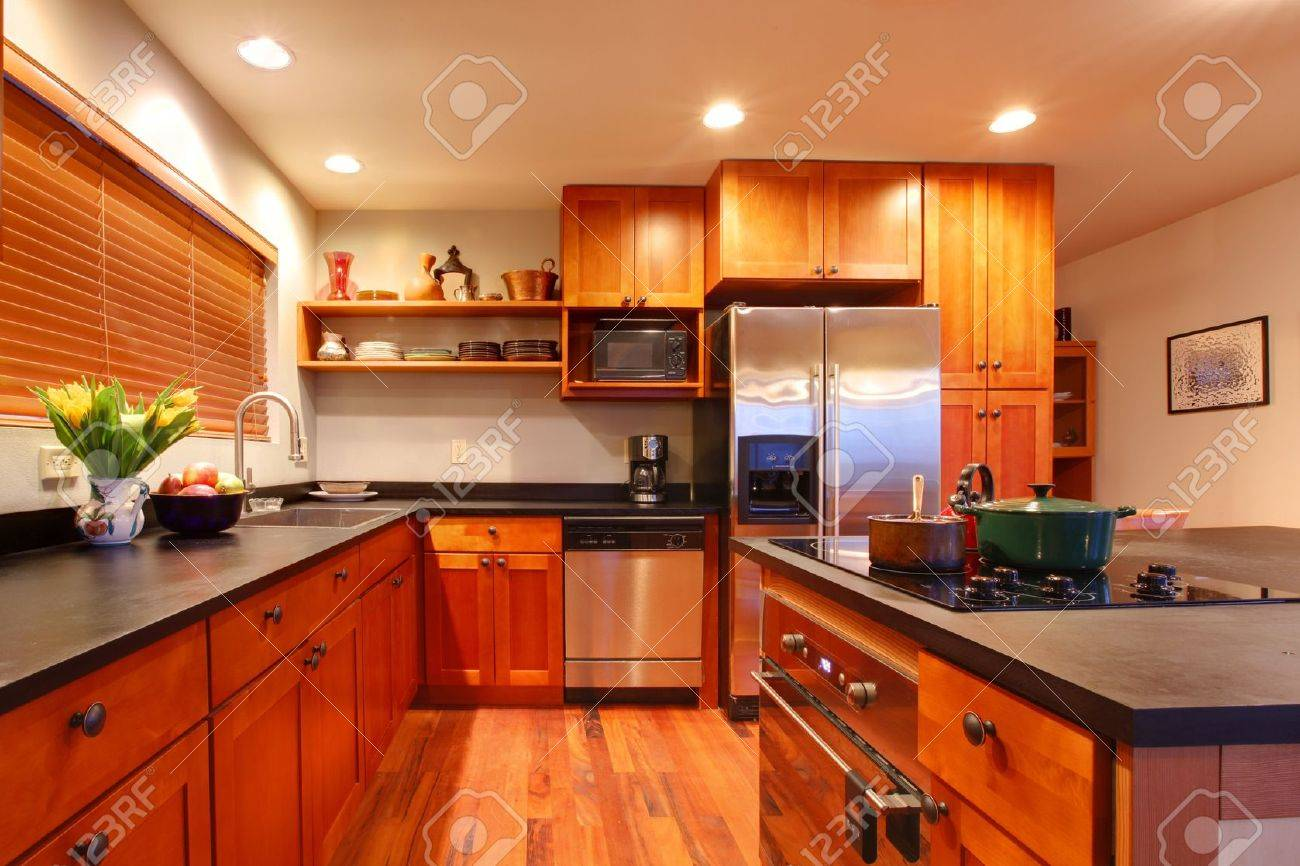 really nice kitchen with cherry wood and hardwood floor stock