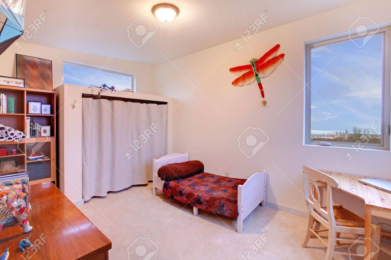 Kids bedroom with small white bed and desk in the corner Stock Photo - 12313169