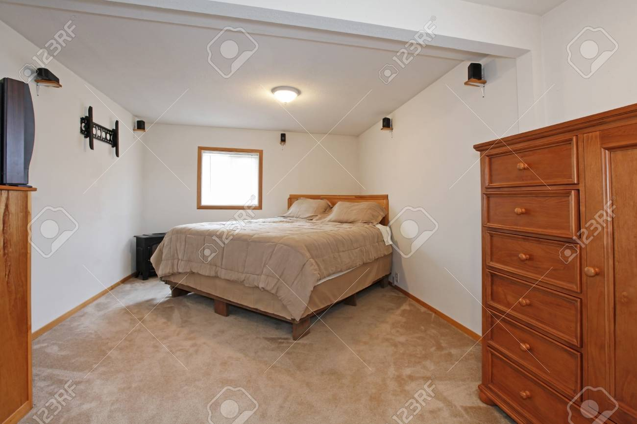 Simple bedroom with one bed and dresser Stock Photo - 12312281