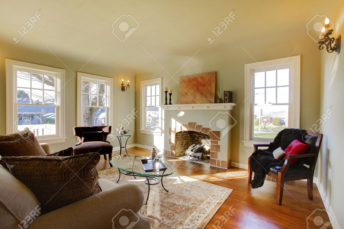 Green Walls, Beige Tones And Cozy Craftsman Style Living Room. Stock Photo    12312252