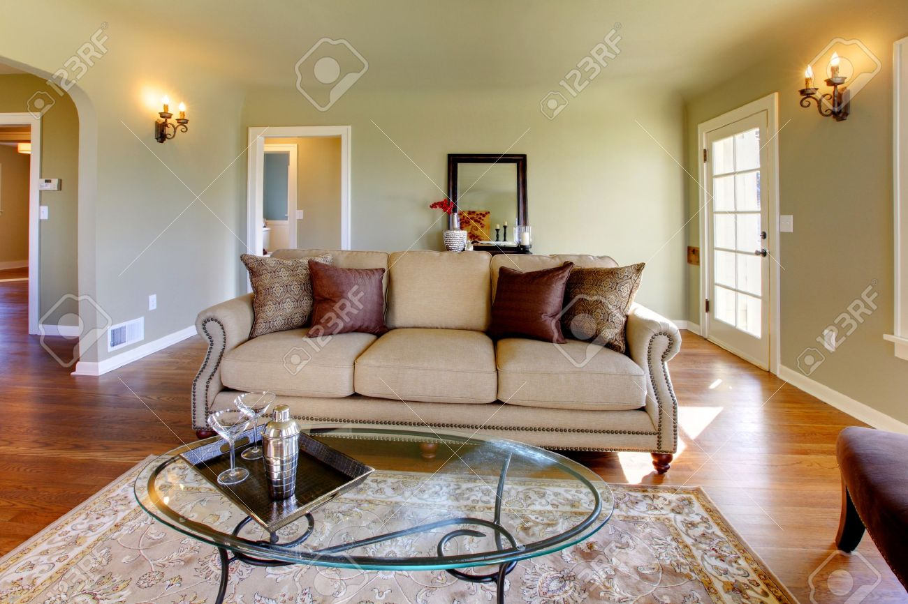 green walls, beige tones and cozy craftsman style living room