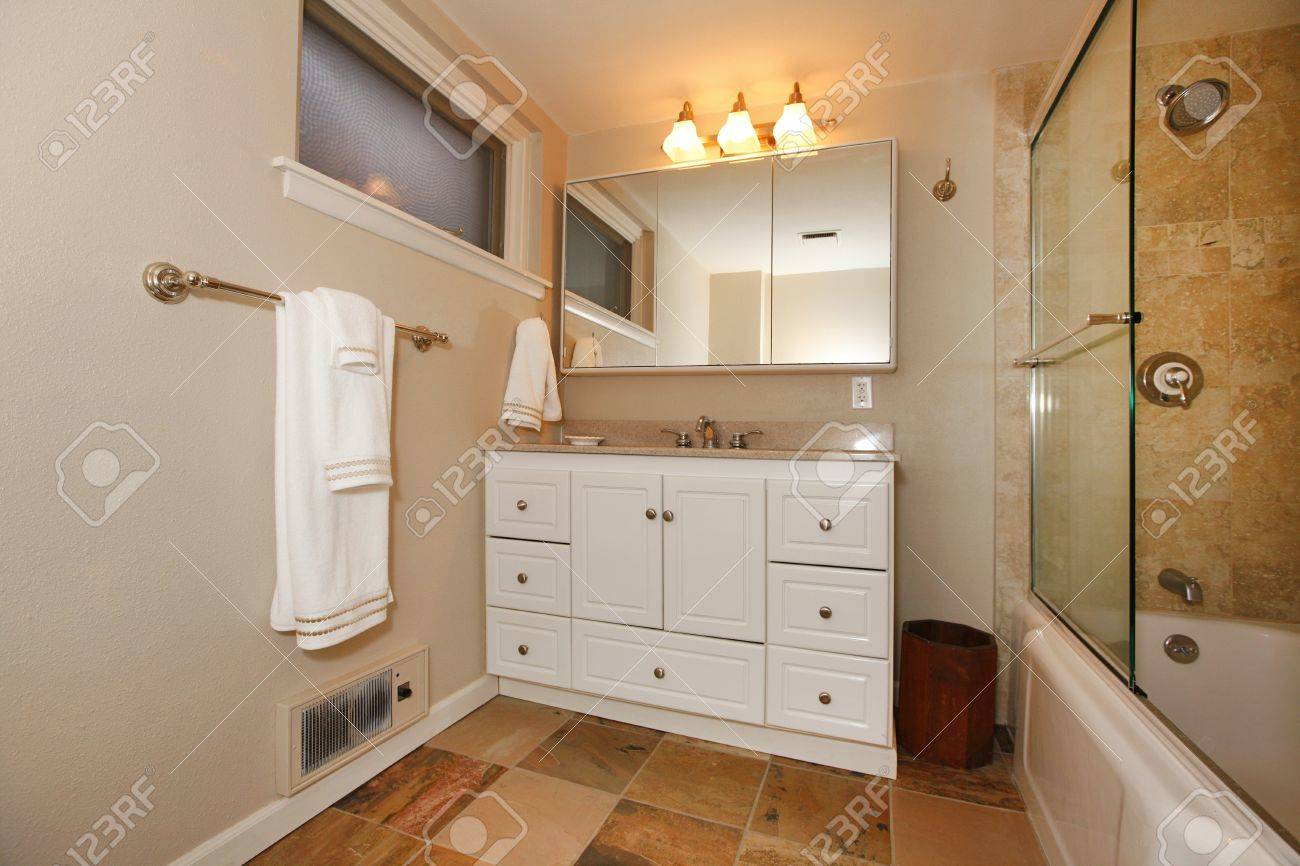 White cabinets bathroom - Nice Bathroom With White Cabinets And Shower Stock Photo 12329583