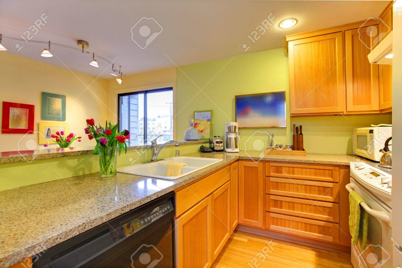 Kitchen With Wood Cabinets And Bright Green Walls Stock Photo Picture And Royalty Free Image Image 12311630