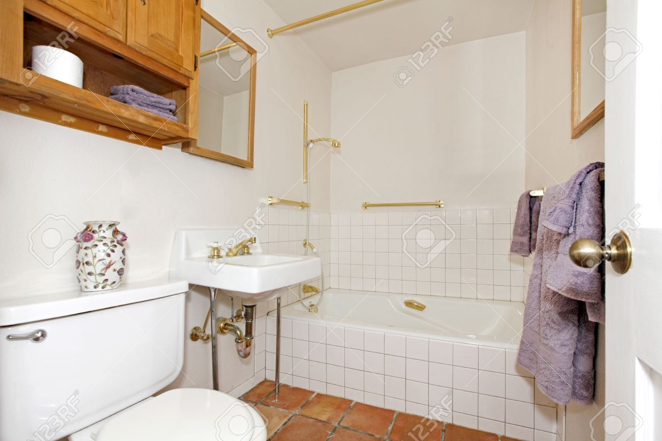 simple white bathroom with purple towels stock photo 12311623 - Simple White Bathrooms