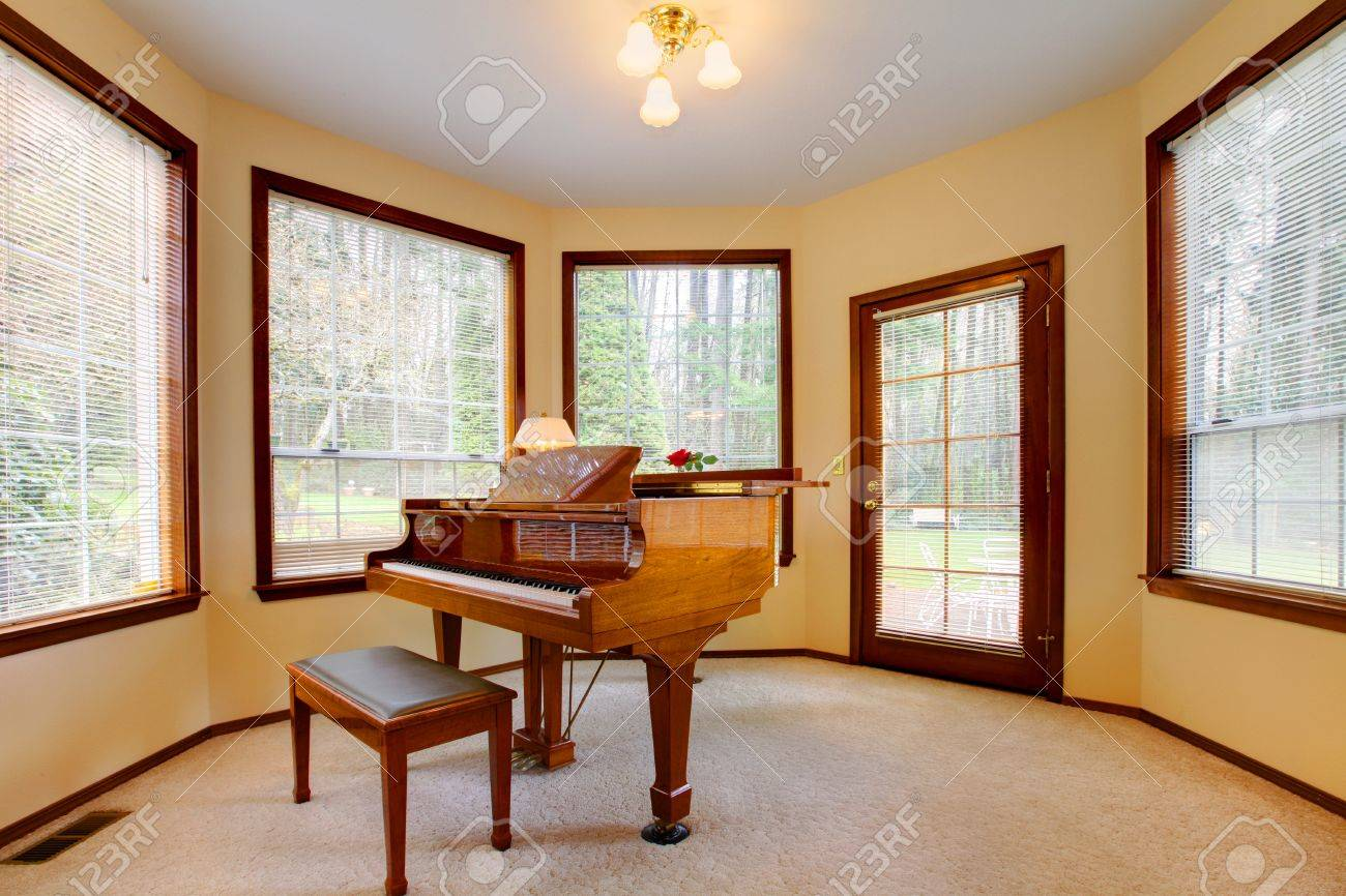 Round room with piano and lots of windows. Stock Photo - 12310482