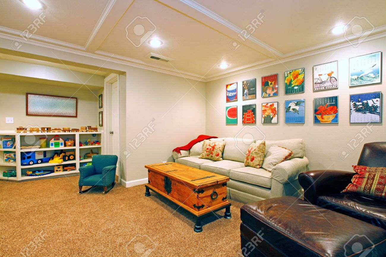 Kids Living Room Play Room In A White Basement Living Room Stock Photo Picture And