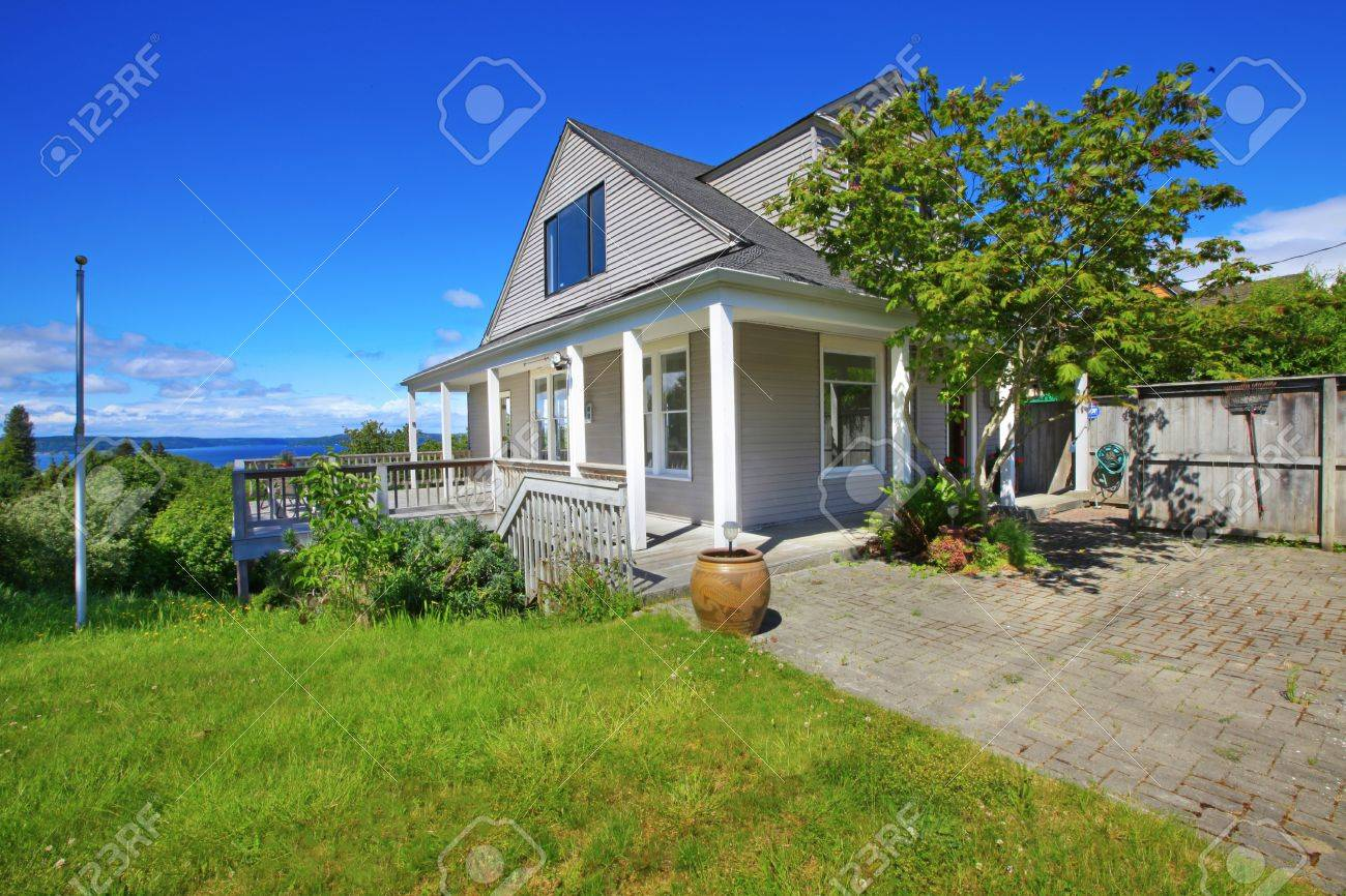 Grey home with grey house with white trim. Stock Photo - 12312178