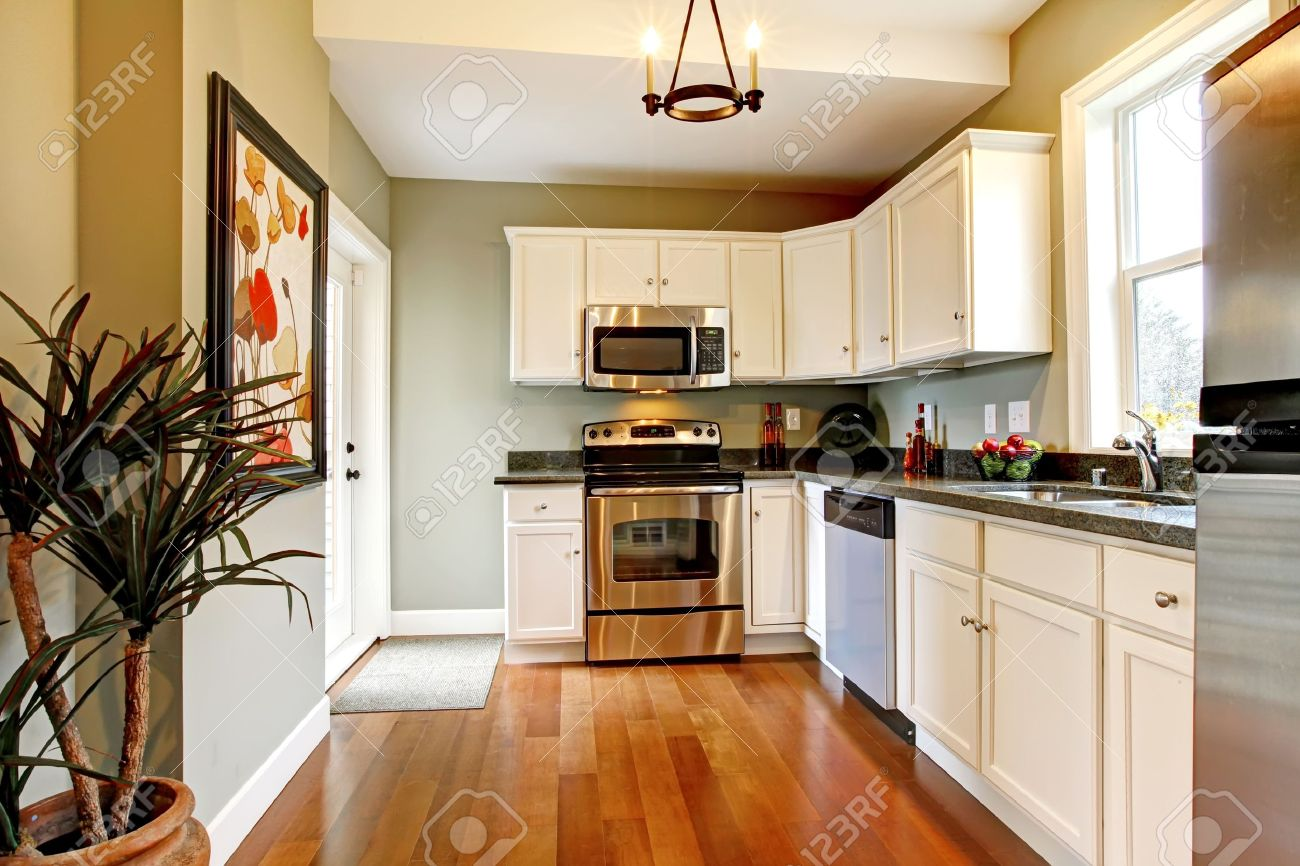 Beautiful White Kitchen Designs Beautiful White Kitchen With Cherry Floor Stock Photo Picture And