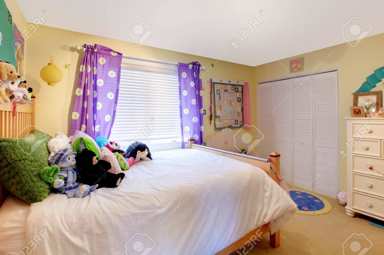 Picture of: Yelow Baby Room With Purple Curtains And Yellow Walls Stock Photo Picture And Royalty Free Image Image 12621208