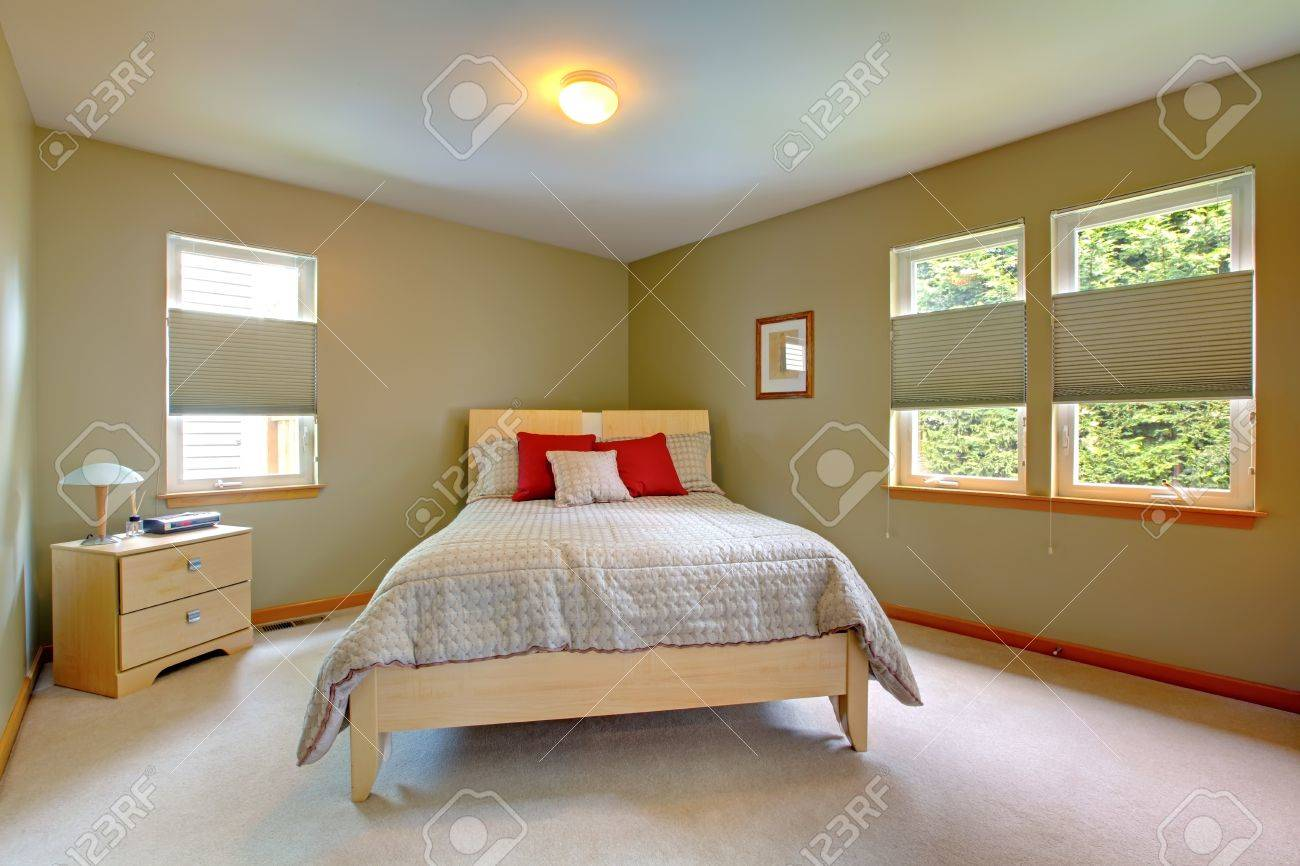 Large and bright room with bed for guests with many windows. Stock Photo - 12621228