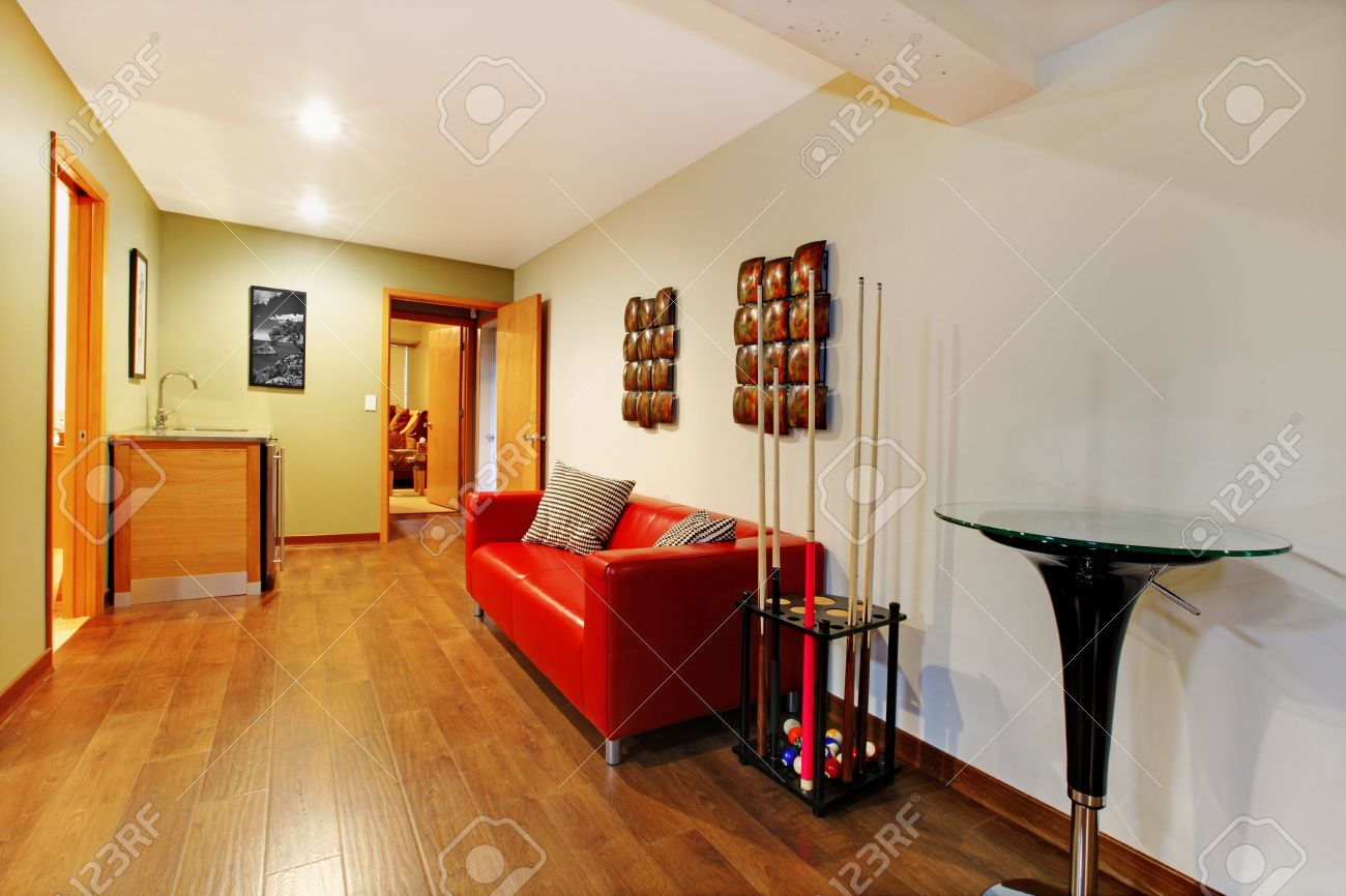 Home interior basement playy room hall way area with red sofa. Stock Photo - 12621253