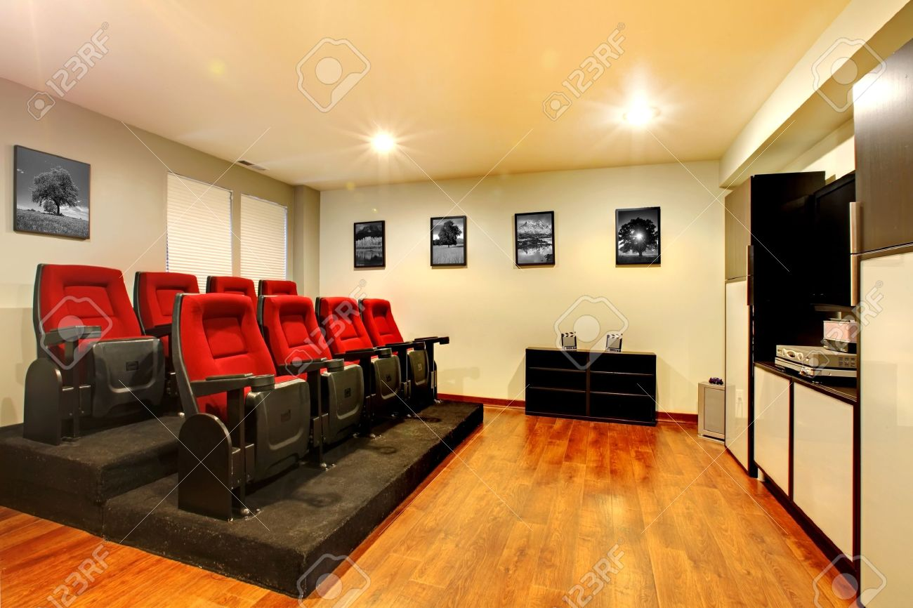 Home TV Movie Theater Entertainment Room Interior With Real Cinema Chairs Stock Photo