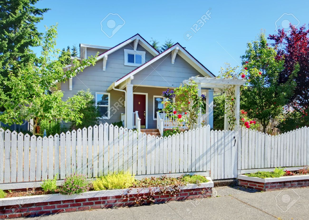 craftsman style house stock photos royalty free craftsman style craftsman style house grey small cute house with white fence and roses