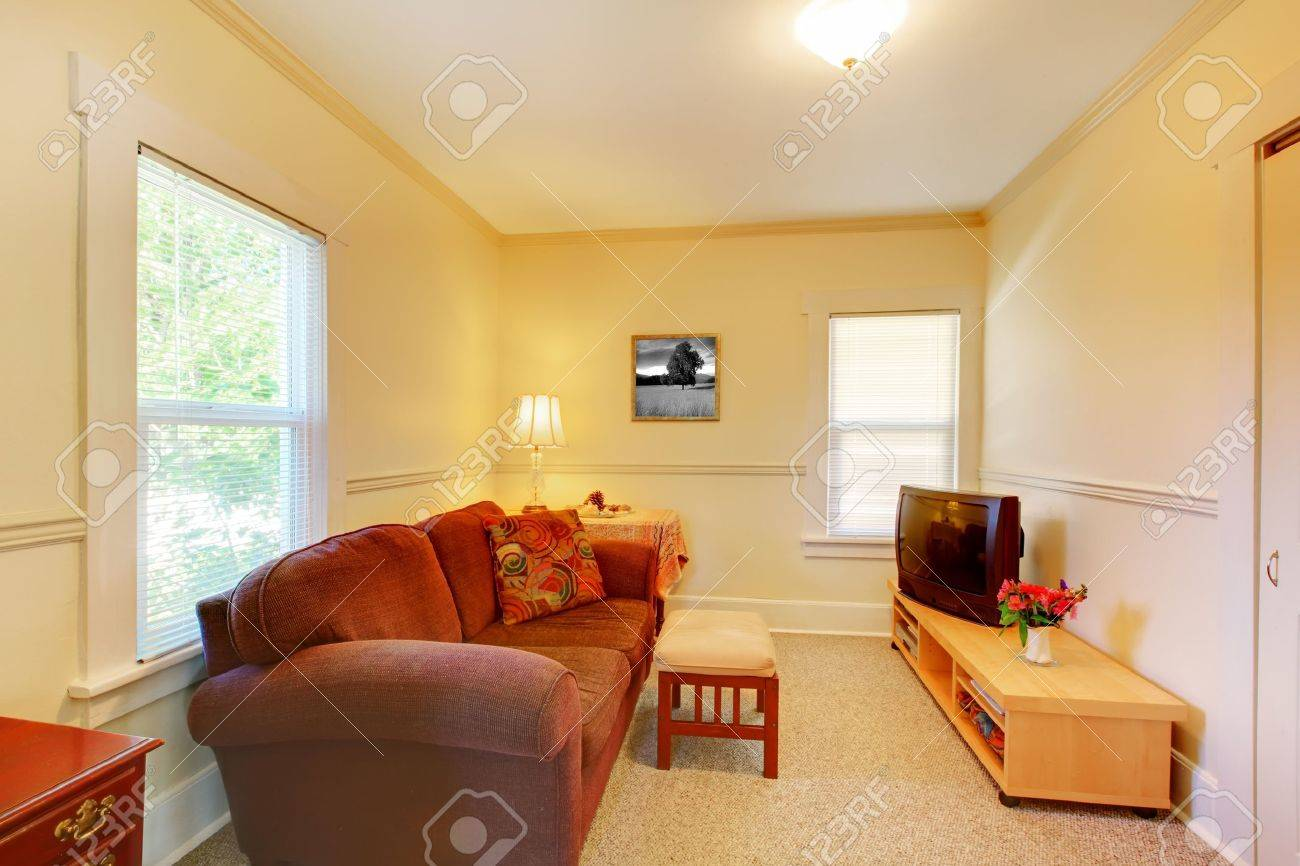 Yellow And Red Living Room Simple Small Yellow Room With Red Sofa And Tv Stock Photo
