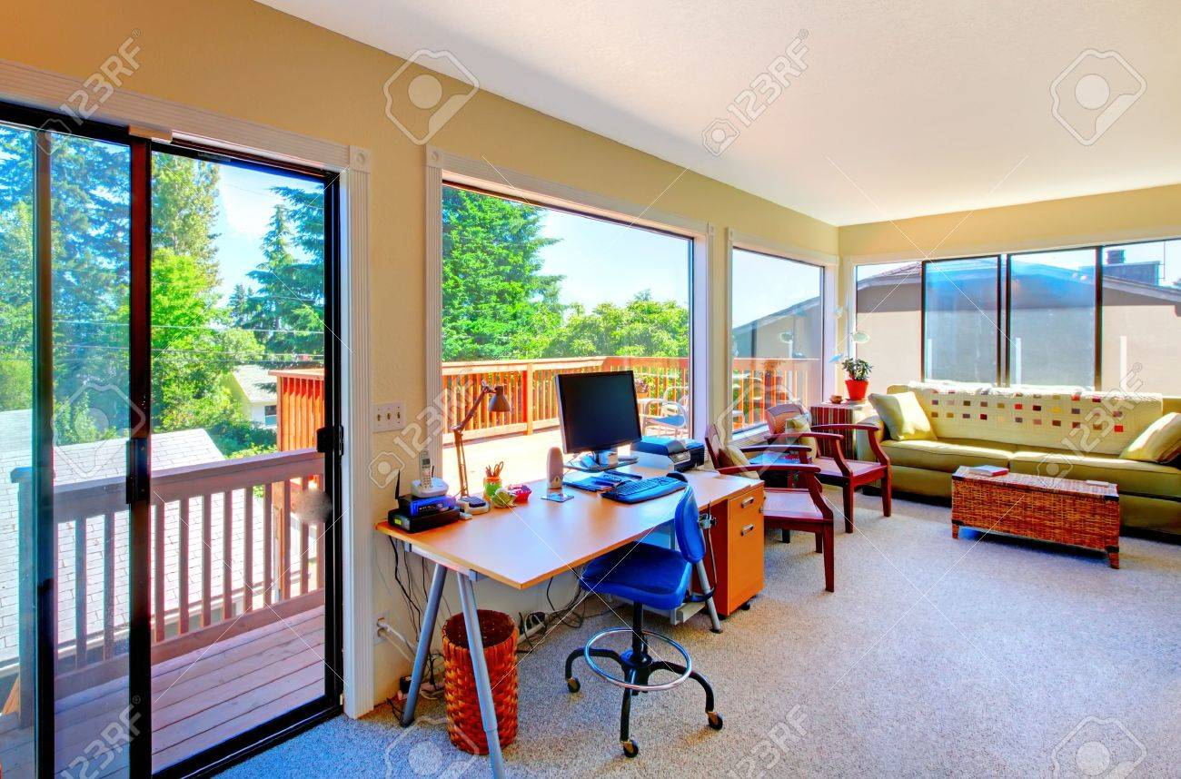 Home office and living room with balcomy view inteior. Stock Photo - 12621440