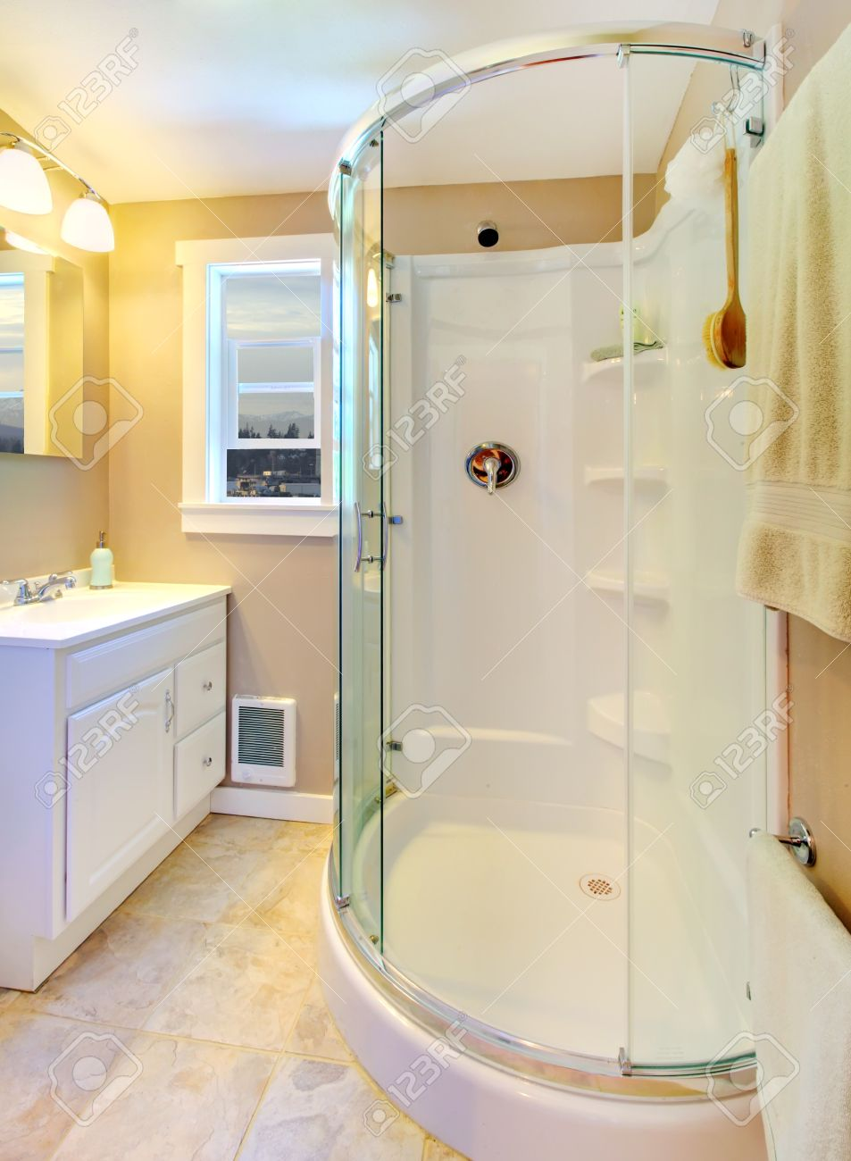 Small Beige Bathroom With Walk In White Shower And White Cabinet ...