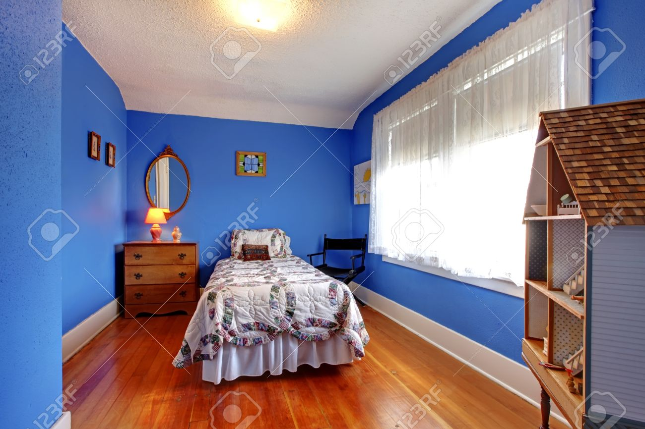 Bright blue kids bedroom in old English style with cherry hardwood floor and doll house. Stock Photo - 12621477