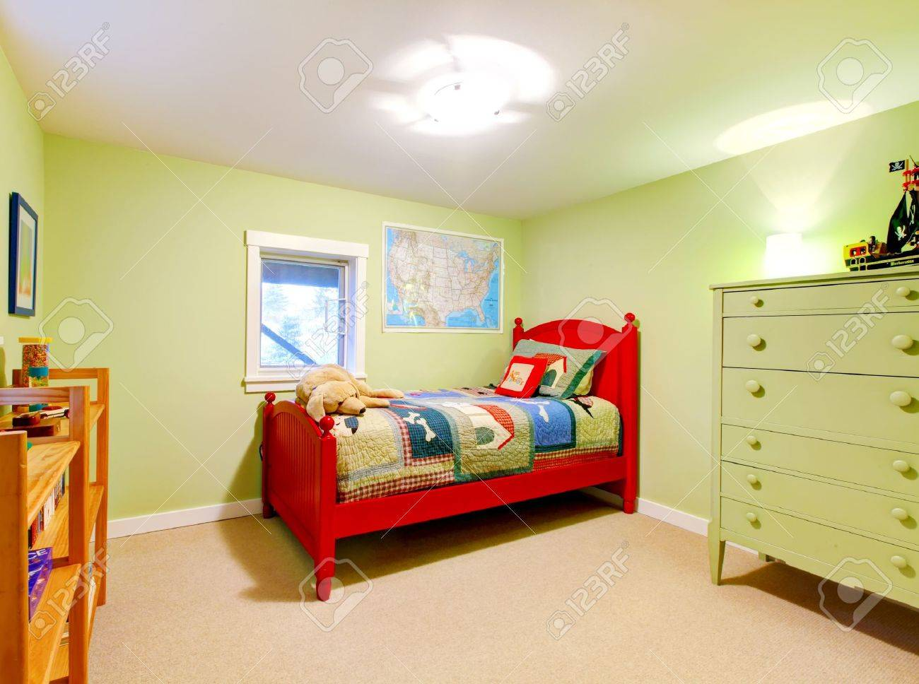 Cute child boy green bedroom with red bed. Stock Photo - 12760824