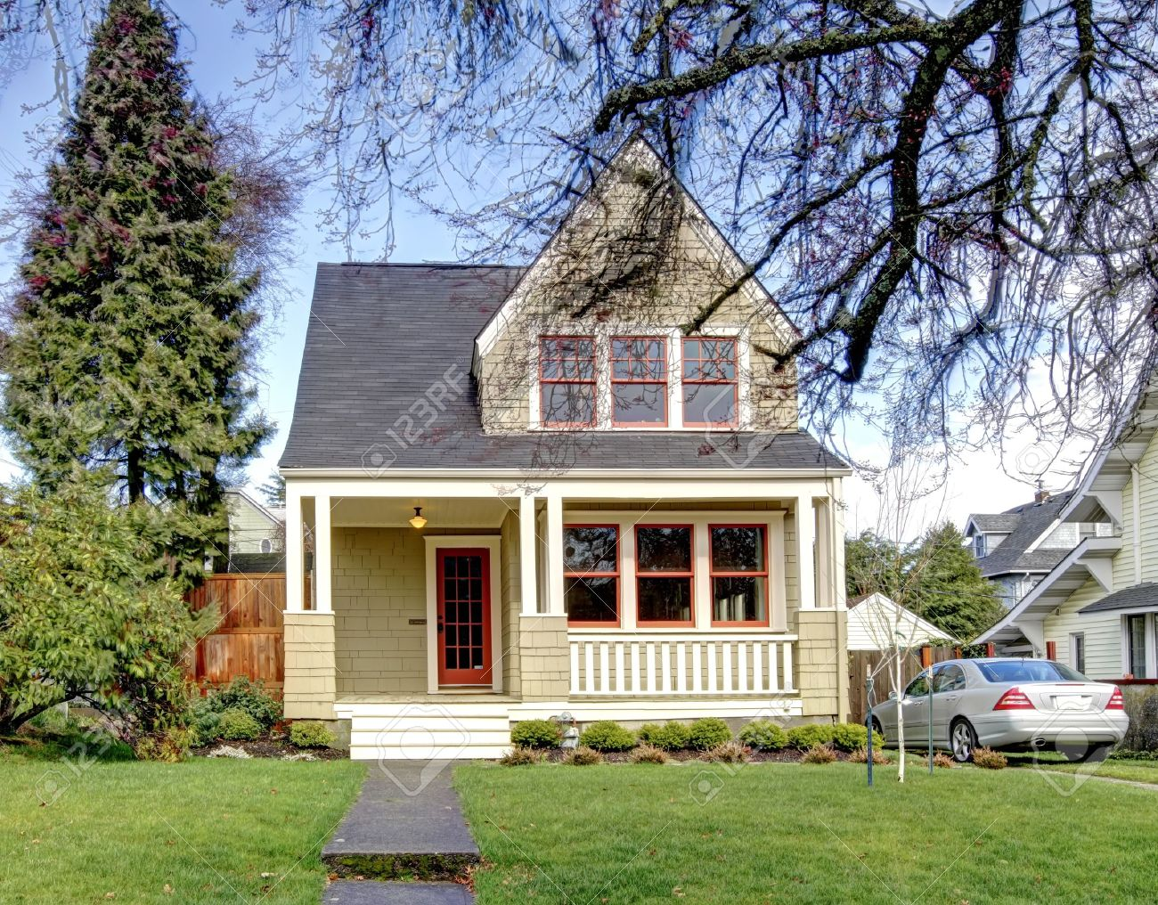 Craftsman Style: Green Craftsman Style House With The Silver Car.