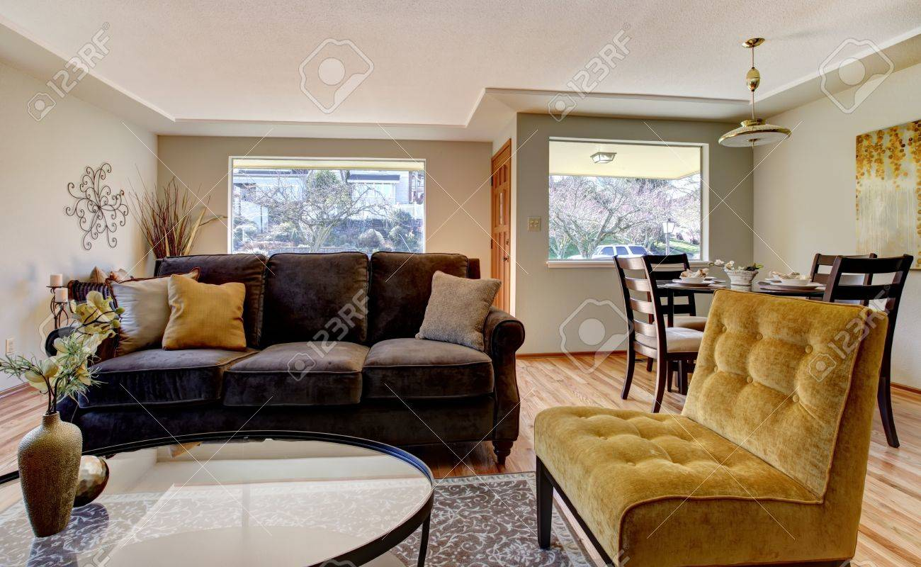 Blue and yellow living room with brown couch - Living Room Interior With Brown And Yellow Furniture Stock Photo 12760875