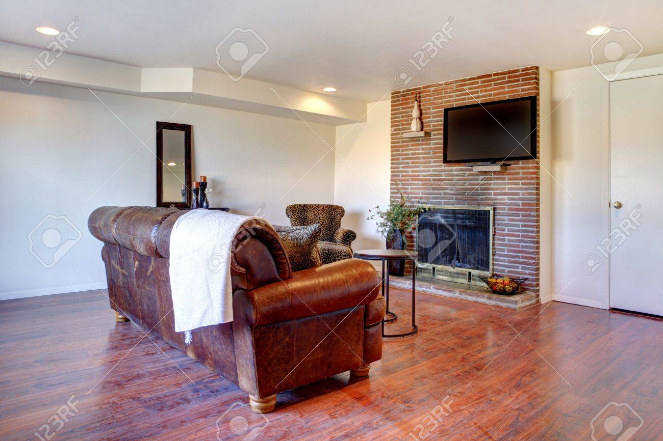 Large white living room with leather sofa and fireplace. Stock Photo - 12760892