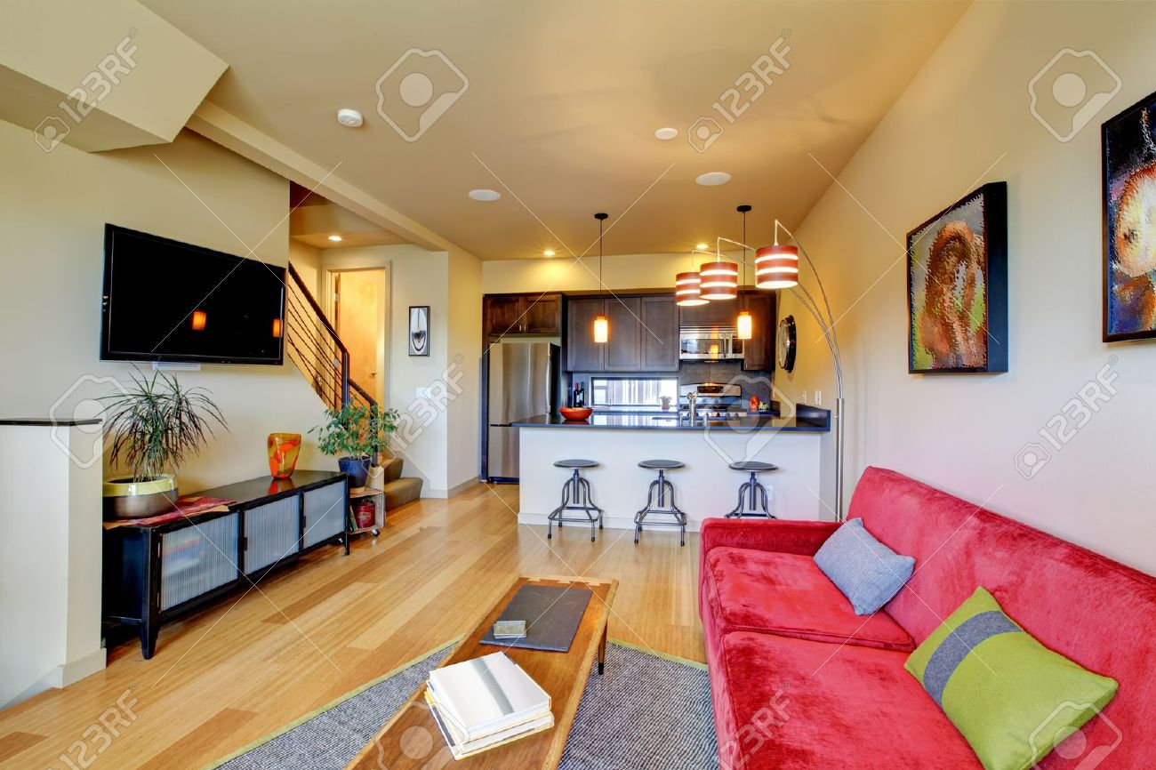 Yellow large living room with red sofa and brown kitchen. Stock Photo - 12913802