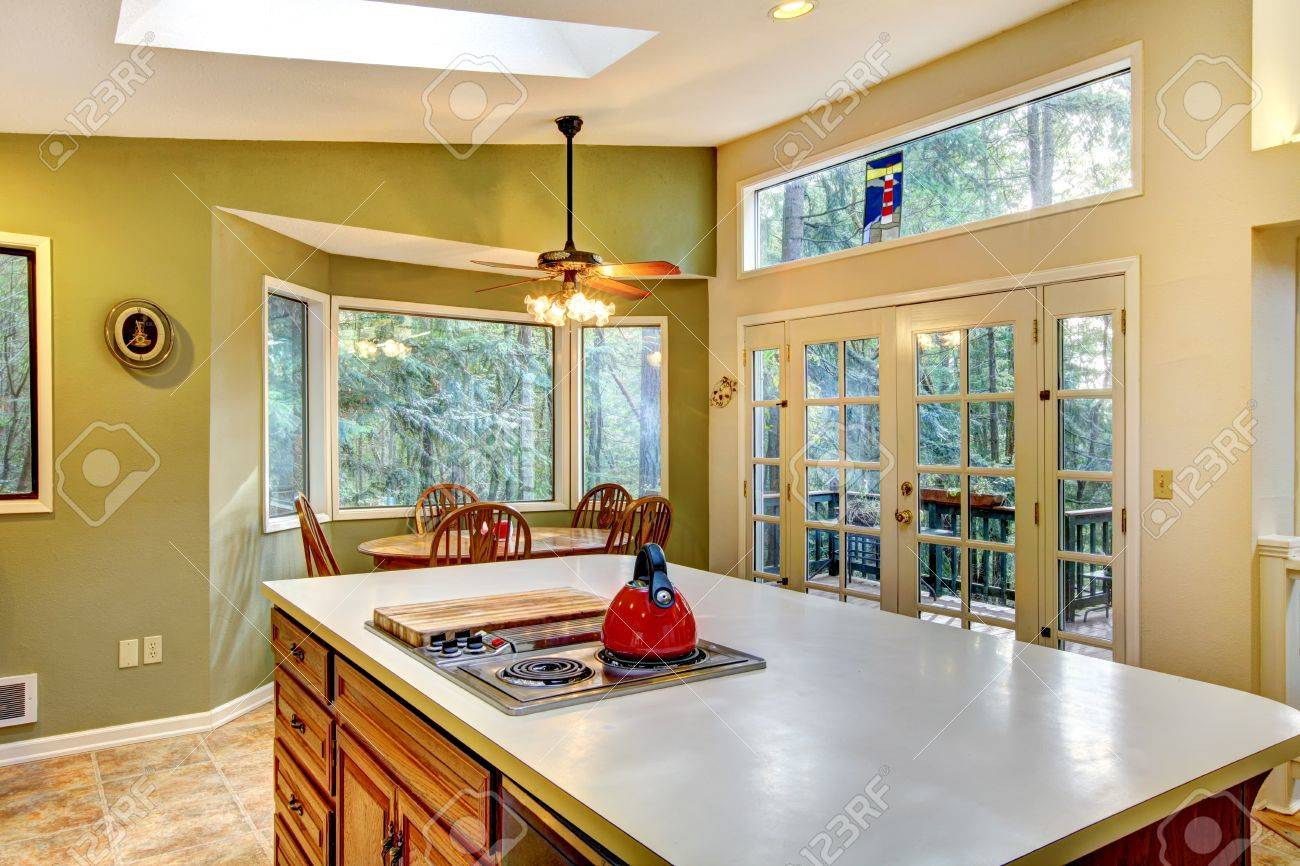 Large green country kitchen with skylights and wood cabinets. Stock Photo - 12913931