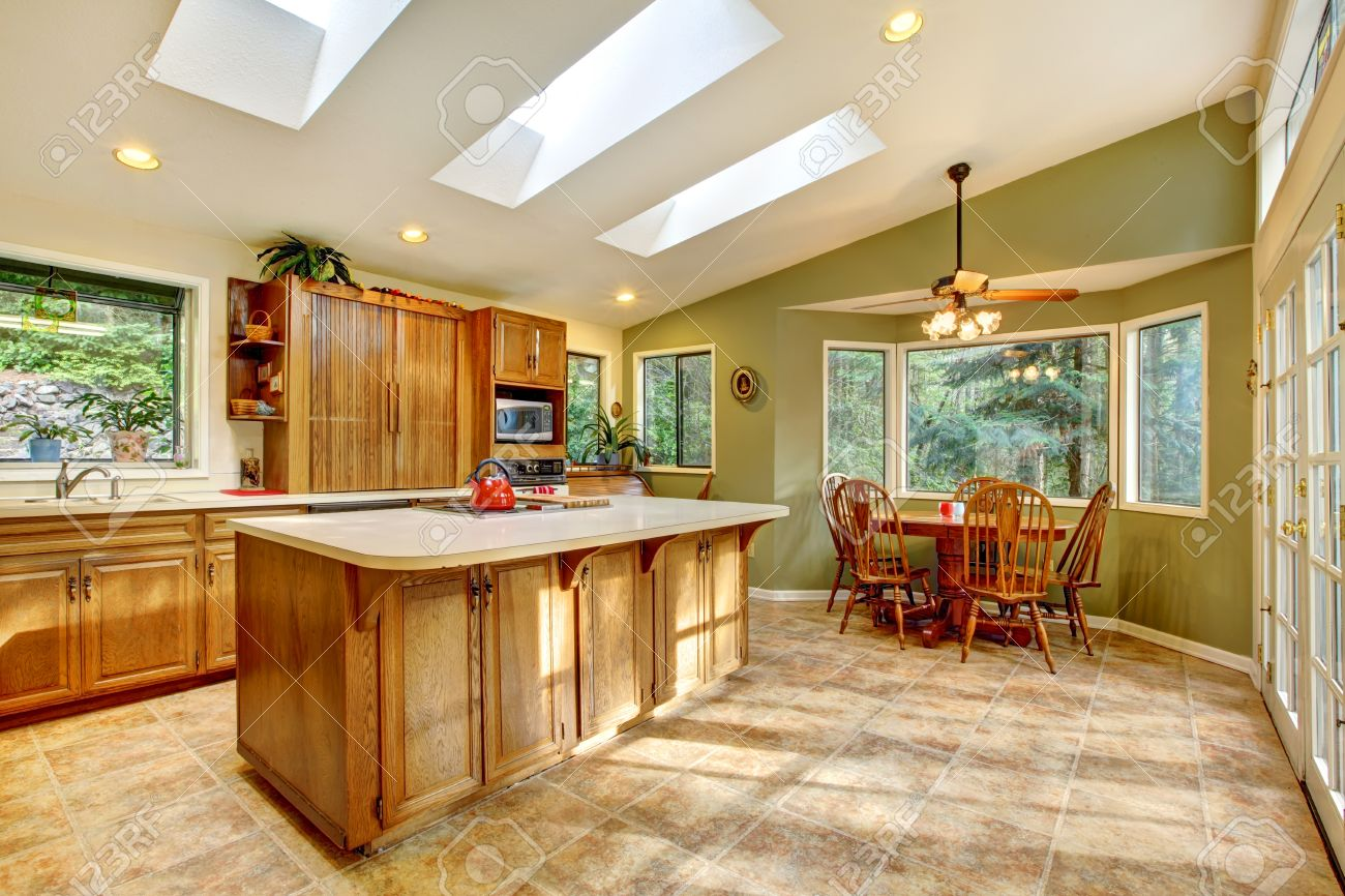 Green country kitchen - Large Green Country Kitchen With Skylights And Wood Cabinets Stock Photo 12913930