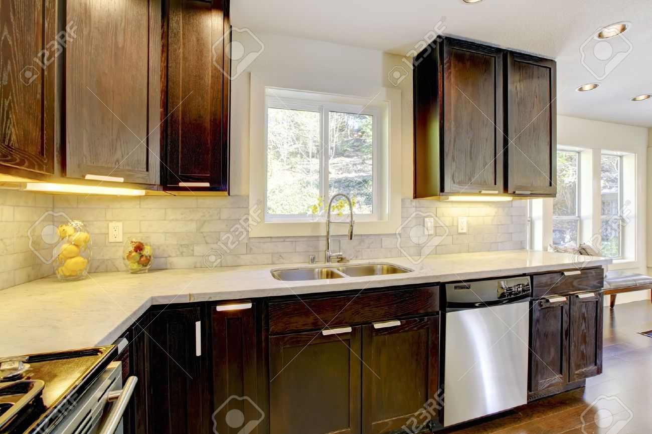 13122558 Modern luxury new dark brown and white kitchen with stainless steal appliances  Stock Photo