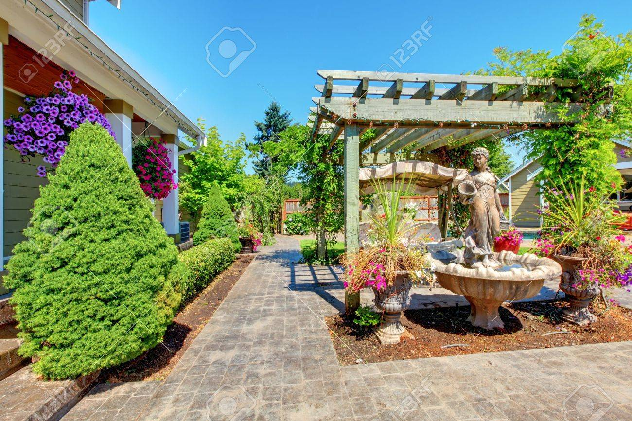 Backyard with outdoor living room and green trees. Stock Photo - 13166573