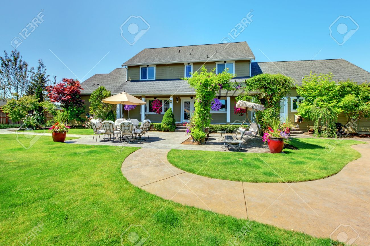 American Country farm luxury house with porch and beautiful flowers. Stock Photo - 13166571