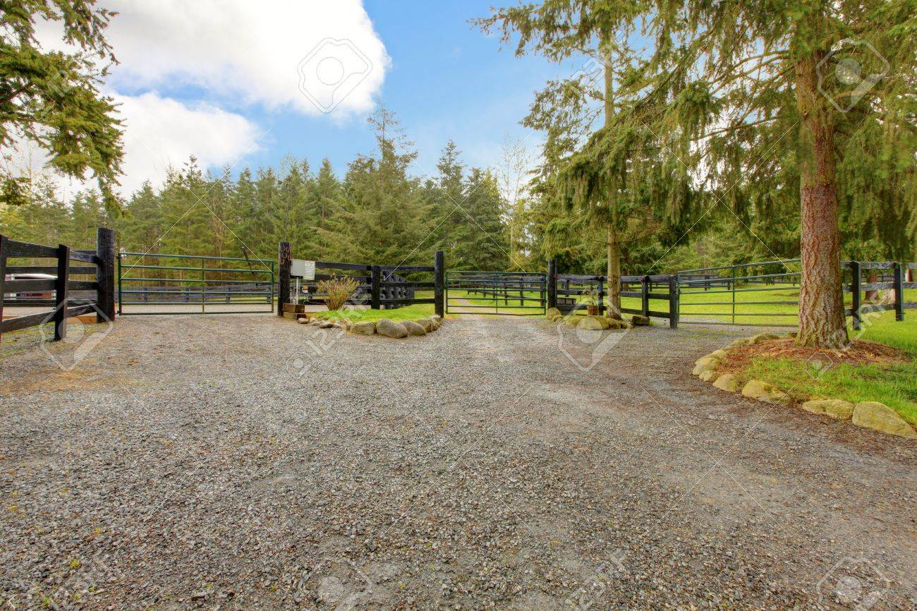 Large horse farm property with three gates. Stock Photo - 13294852